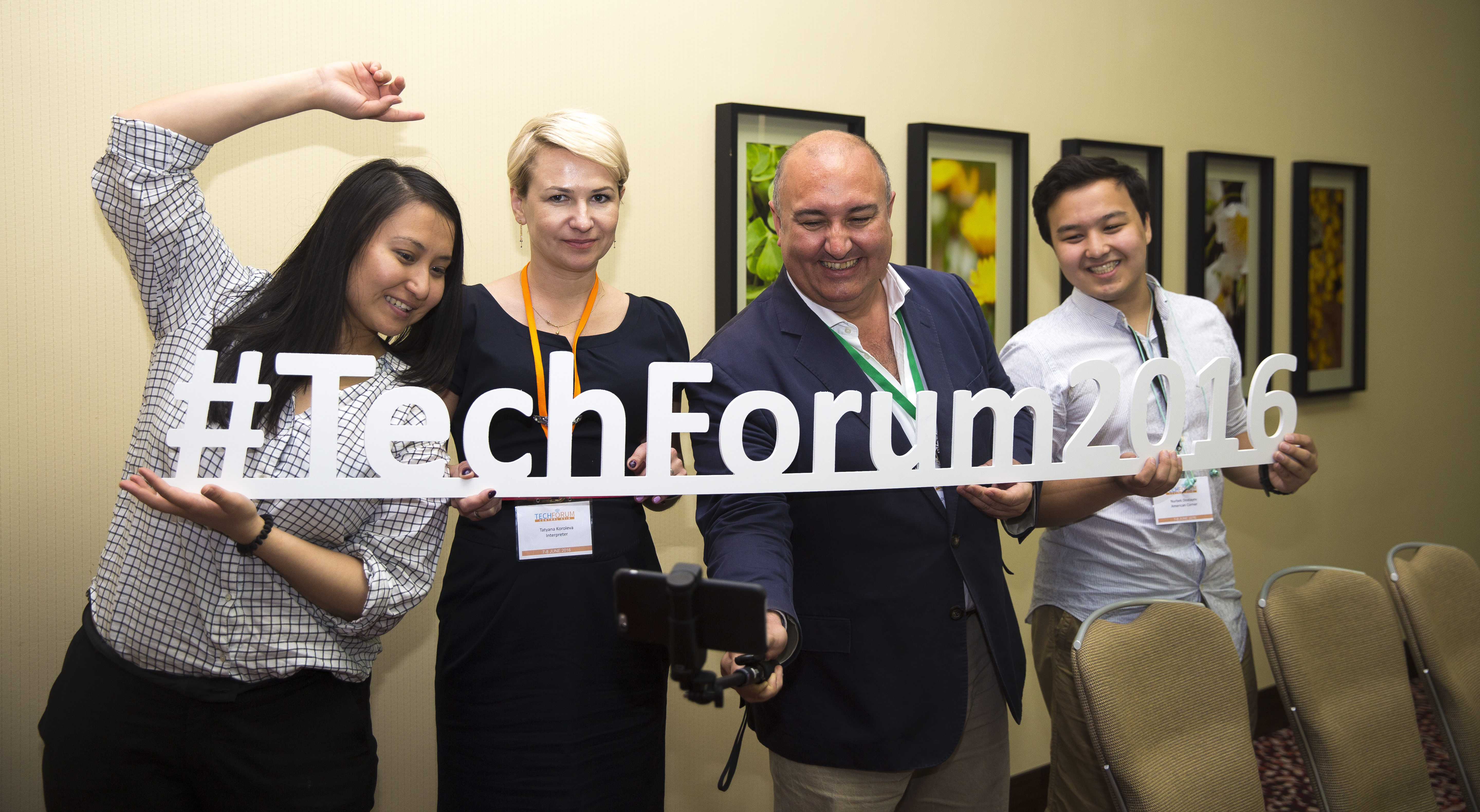 TechForum Central Asia participants and trainers posing with hashtags during a break