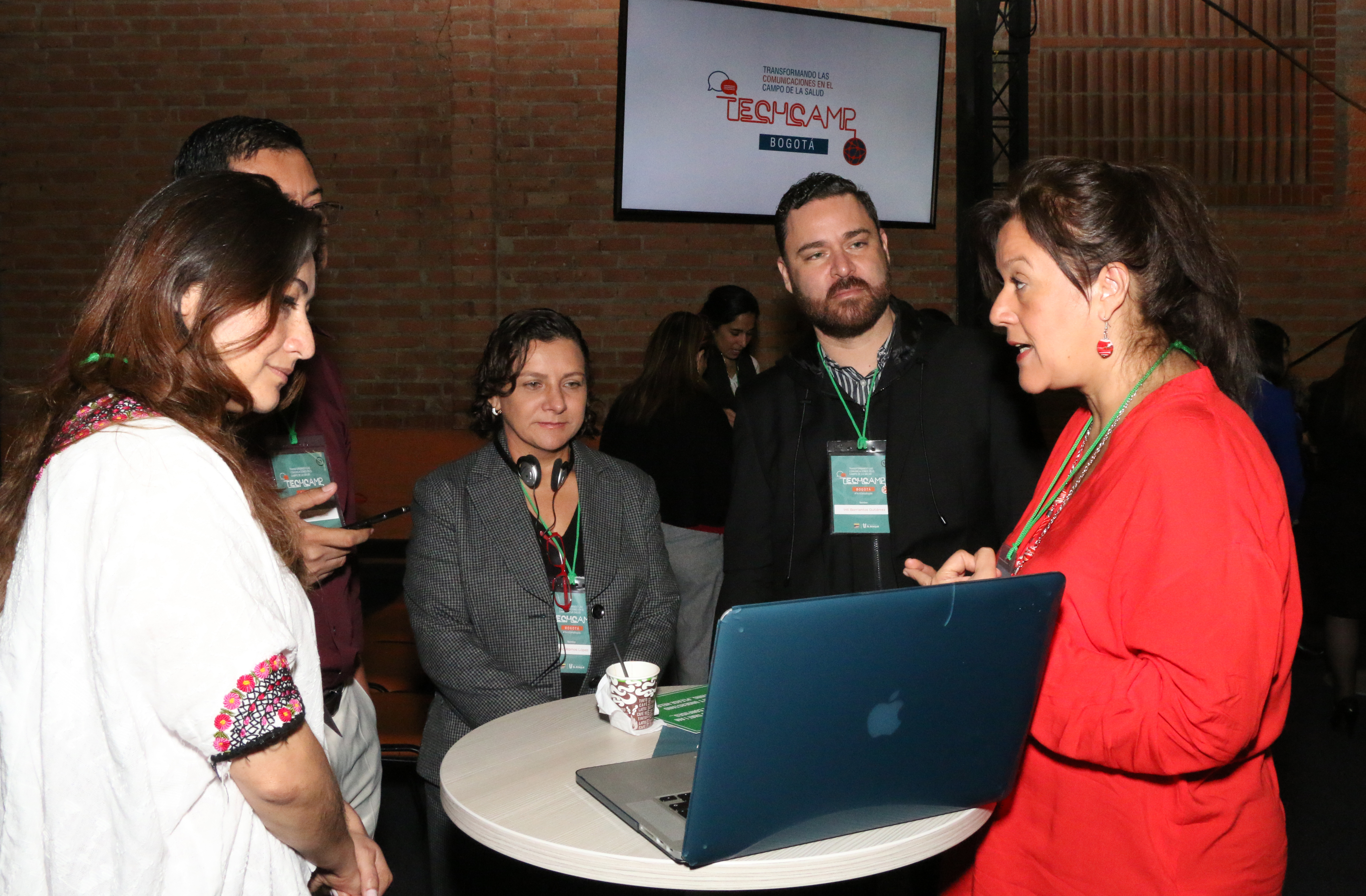 A trainer explains a low cost technology tool to TechCamp Bogota participants.
