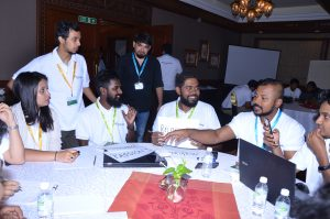 Participants share their thoughts during an interactive breakout session.