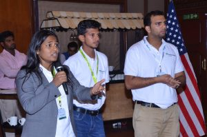 A team of participants pitch their solution to the panel of judges.